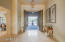 Double door entry to a grand foyer