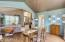 Decorator colors and gorgeous hardwood floors adorn this beautiful area