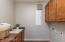 Deep porcelain sink and cabinets for additional storage