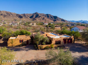 1.16 acres mountain-view retreat with pool, detached casita, pond, fire pit sitting area, extensive mature landscaping, courtyards, all minutes to downtown Phoenix.