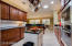 Overhead accent lighting over cherry cabinets and under task lighting on both sides of Kitchen