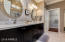 Custom Vanities with Granite Counter, far end shows Linen Closet and entry to Walk-in Shower