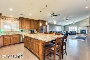 Large custom counter top 5.5ft X 8.ft. with custom chairs which will convey with the property.