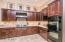 Recently remodeled kitchen including roll out shelves, Double Ovens, 4 Burner Gas Viking Cook top and Griddle