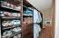 Love the organization that this master upstairs walk-in closet offers