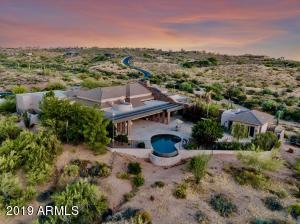 Watch the sunset over your 4 acres of natural desert landscape.