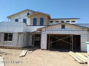 Front elevation & front yard desert landscape to be completed.