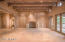 14' ceilings with parallel latilla, hand-hewed beams and corbels ceiling detail, along with all plaster walls, and a massive hand-built fireplace