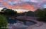 Stunning sunset over the golf course and pool