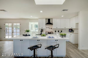 Spacious kitchen with brand new cabinets, stainless steel appliances, marble counters and over sized island.