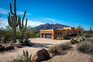 You'll enjoy this highly-upgraded territorial home on a large private lot of over 6 acres, with no HOA, and no steps!