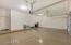 3 car garage with epoxy coated flooring