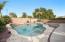 Travertine tile surround an d professional desert landscaped backyard.