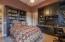 Second en-suite bedroom complete with built-in desk and bookshelves.