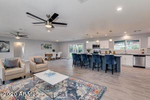Open concept kitchen, dining and living room.