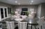 The dining area, located off the kitchen is so large it can be flexed to use for your family's needs. It is currently set up as a dining area and heart area.