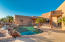 Backyard with Pool and Waterfall feature.