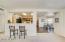 Wide open floor plan with the breakfast bar between the kitchen and great room. Informal dining in the breakfast room.