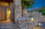 Custom front paver and stone patio with built in seating