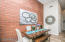 Real floor to ceiling brick wall accents the entire space!