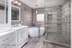 Spectacular remodeled owner's bath with wood plank tile straight up the wall!