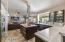 Custom cabinets with lighting, huge island and quartz countertops