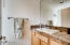Powder Room on main level features upgraded granite countertops , sink and toilet.