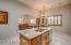 Kitchen opens into large dining room