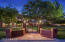 Privately gated Arcadia Estate with mature landscaping and sweeping front lawns