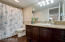 Full bathroom downstairs- upgraded cabinets, granite counters and tiled shower/tub