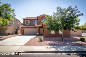 Large corner lot with easy to care for desert landscaping.