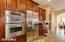 Kitchen - double ovens & built in fridge