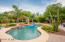 Notice all the amenities here - pool, decking, patios, grassy play areas and lush landscaping!