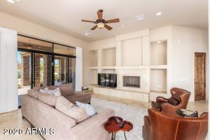 GREAT ROOM HAS LARGE SLIDING DOOR, FIREPLACE, TALL CEILINGS, OPENS TO THE KITCHEN, AND EAT-IN KITCHEN AREAS.