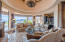 Formal living room shares access to bar & cooled wine room