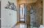 Hallway bath accessible to pool & spa