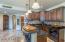 Lower level boasts mini-kitchen with fridge, sink & microwave