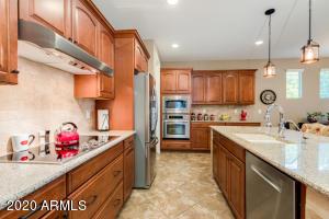Gourmet kitchen w/ maple cabinets, built-in oven & french door fridge