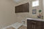 Upstairs Laundry Room with Cabinets on both sides!