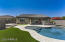 Custom artificial turf surrounds this custom swimming pool and spa