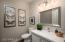 New vanity, mirror, light fixture, sink and toilet.