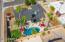 Huge backyard with enormous newly pebble tec surface pool, ramada, fireplace, big pool deck area, plenty of grass!