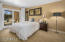 Large guest bedroom with entry to backyard and your own private courtyard.