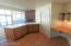 Open to dining & great room, peninsula makes a great serving area. Pantry & desk
