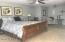 Spacious master bedroom with lake views and access to upper deck