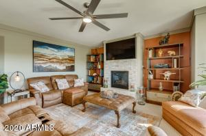 Nicely appointed Living Room with beautifully tiled gas fireplace and custom designer paint & window covers throughout