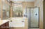Separate soaking tub and shower.