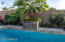 Huge new pebble-tec interior pool with a water feature! Very tropical with mature palm trees all around!