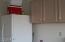 Garage cabinets and fridge