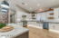 Kitchen - great room, wood floors, quartz and porcelain counter tops, separate fridge and freezer, gas stove, under cabinet lighting